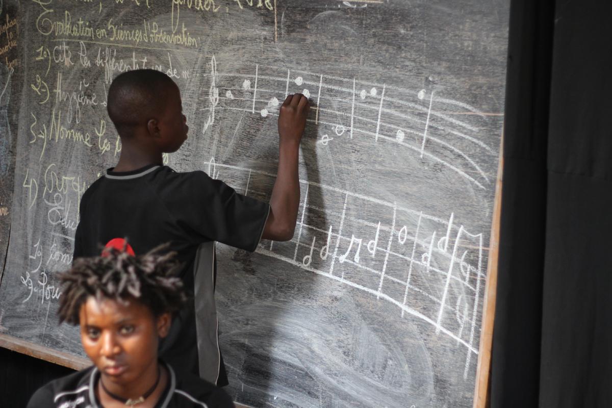Seydouba writing on blackboard