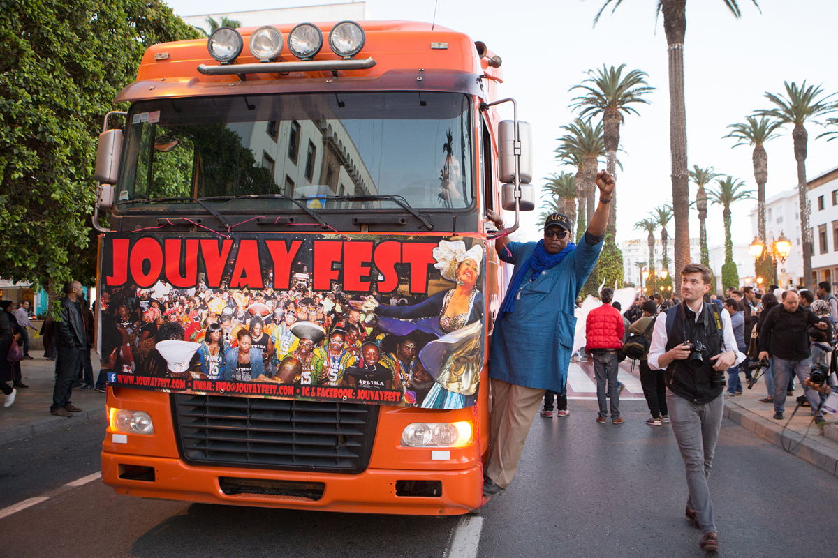 Alex Boicel rolls into town with World Music Fire January 3rd at SOBs. The APAP showcase features artists from across the African diaspora . Pictured: Alex on Mohammed 5 Avenue, Rabat Morocco with the JouvayFest parade which opened the 2017 Visa For Music conference