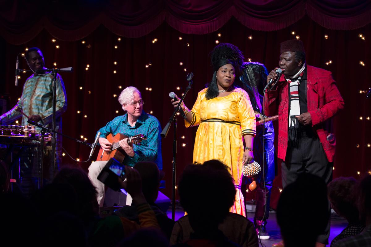 Malian supergroup Trio da Kali, Hawa Kasse Mady, vocals; Mamadou Kouyaté, bass ngoni; Fodé Lassana Diabaté, balafon with guests Banning Eyre on guitar and griot Kassé Mady Diabate, right, vocals; perfoming at Brooklyn Bowl.
