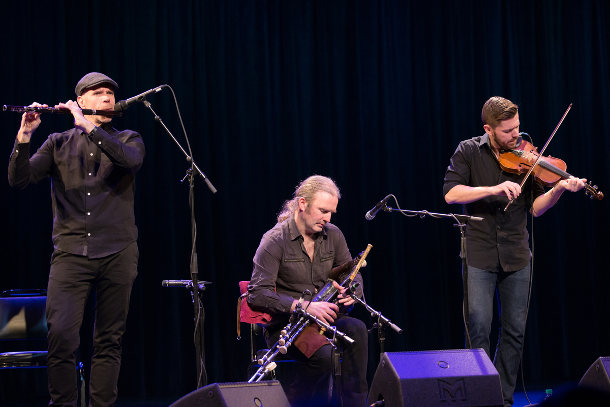 Lúnasa members (L-R) Kevin Crawford (flutes, low whistles and tin whistles), Cillian Vallely (uilleann pipes and low whistles) Seán Smyth (fiddle and low whistle).