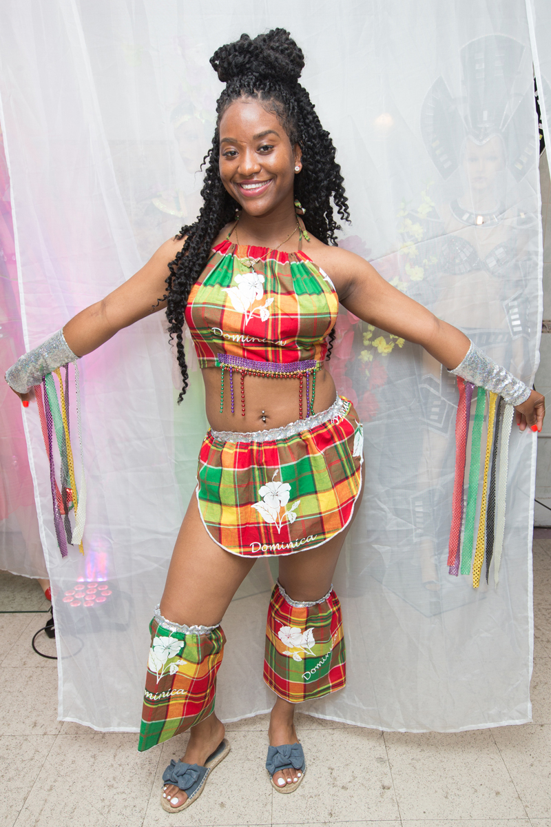 Tiffany Stevenson modeling a costume incorporating the patterns of Dominican traditional creole wear.