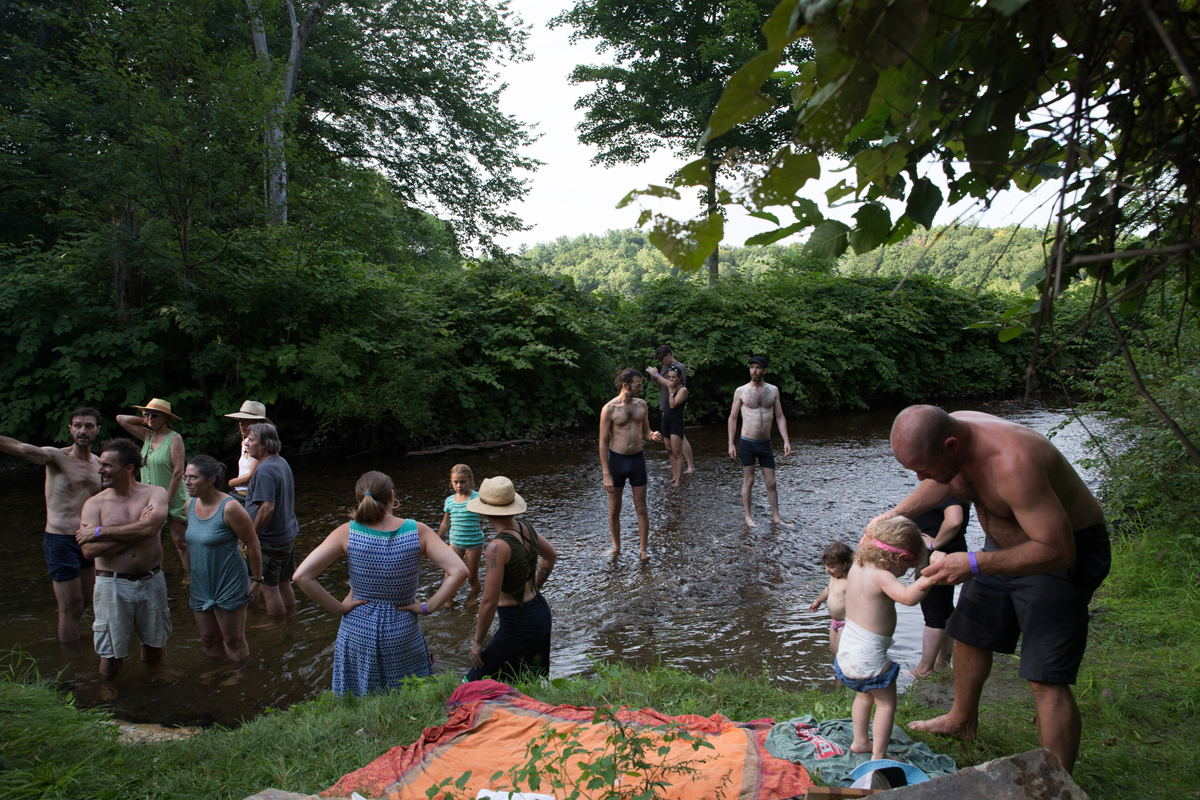 Fans cooling off in the Saw Mill River behind the Grove stage