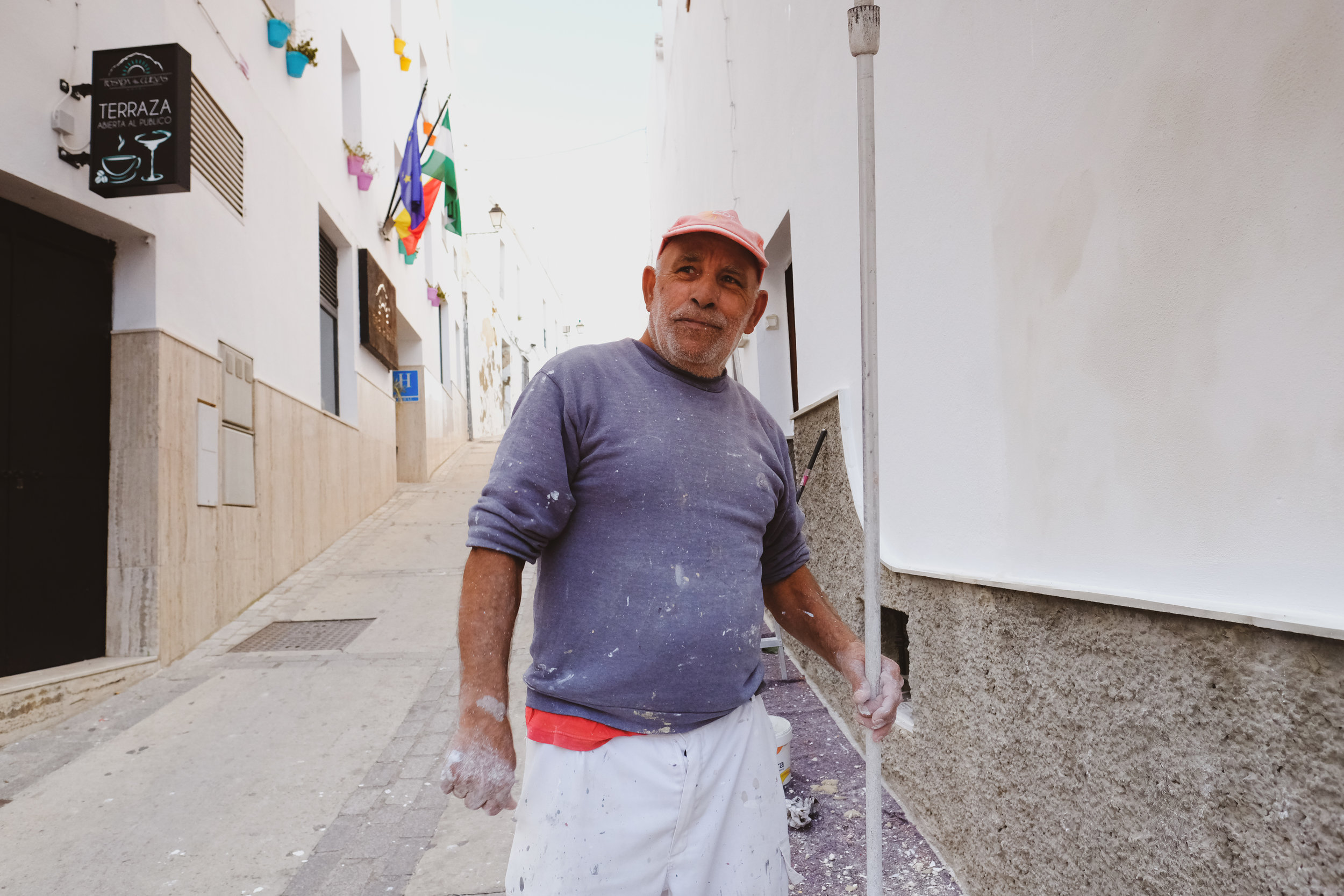 A painter in the streets of Arcos de la Fronterra.