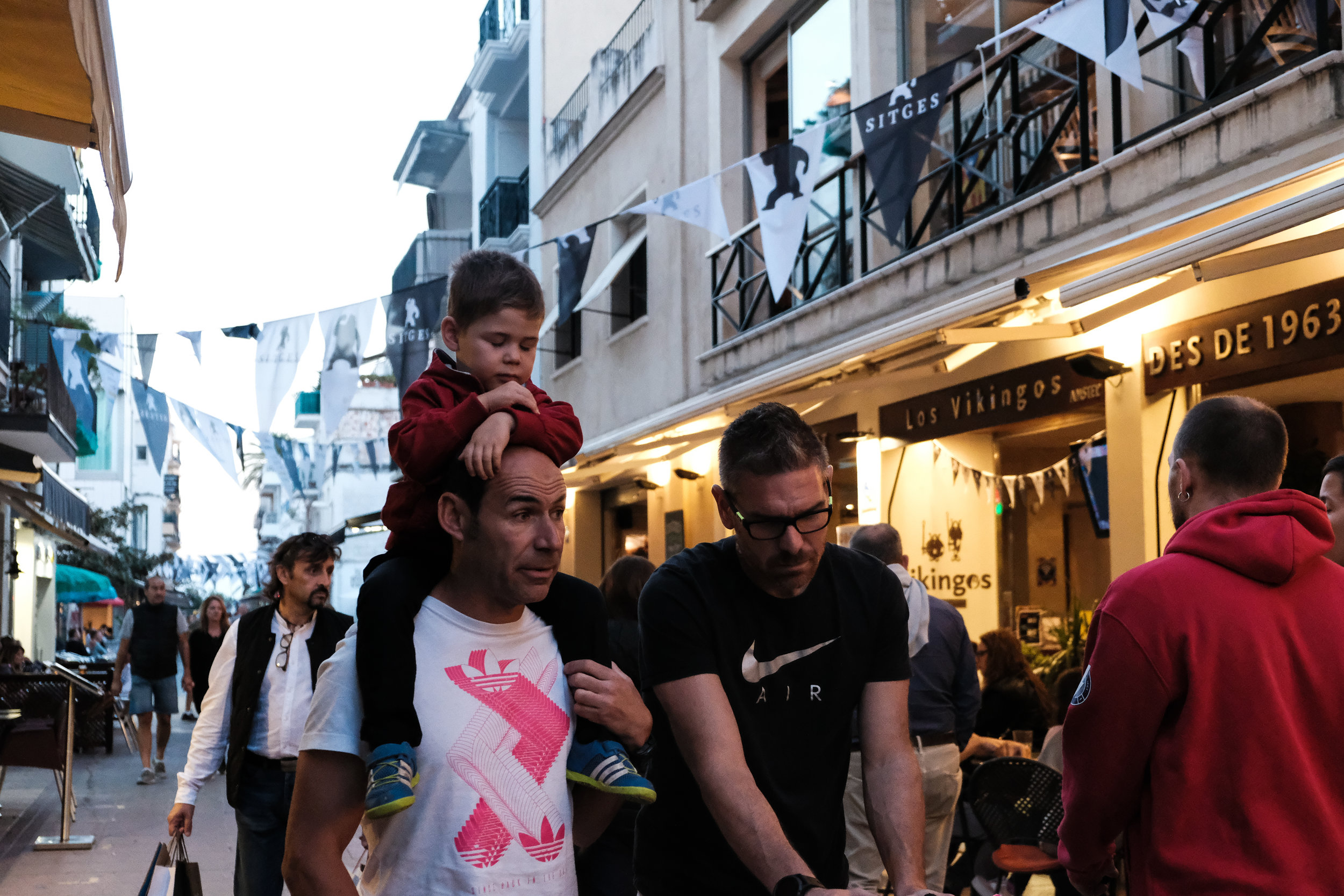 Family on the street in Sitges, Catalonia.