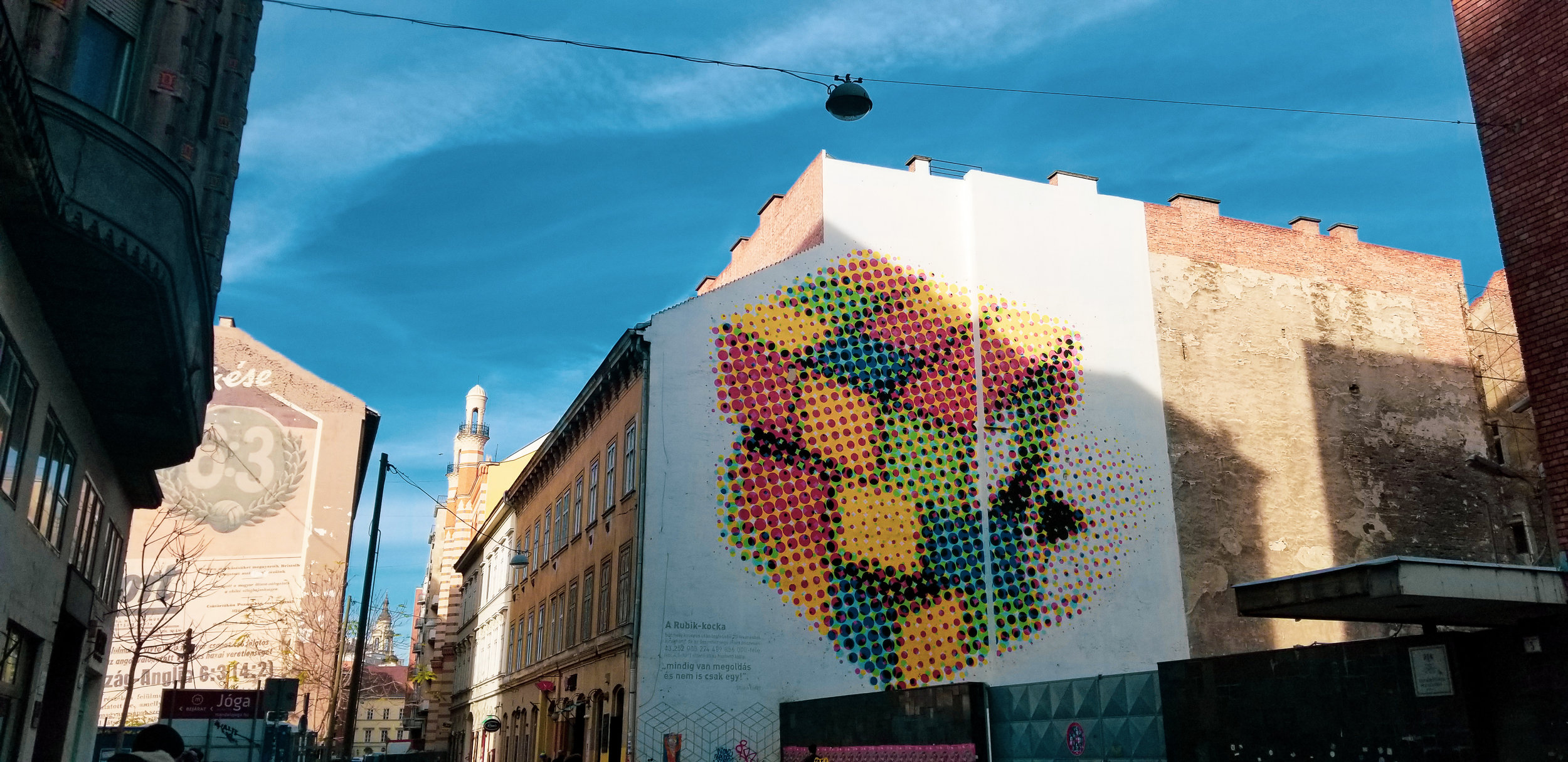 """The Rubik's Cube was invented by Hungarian Ernő Rubik. According to the artist, this mural reflects on the fact that in life """"there is always a solution – and not just one."""""""