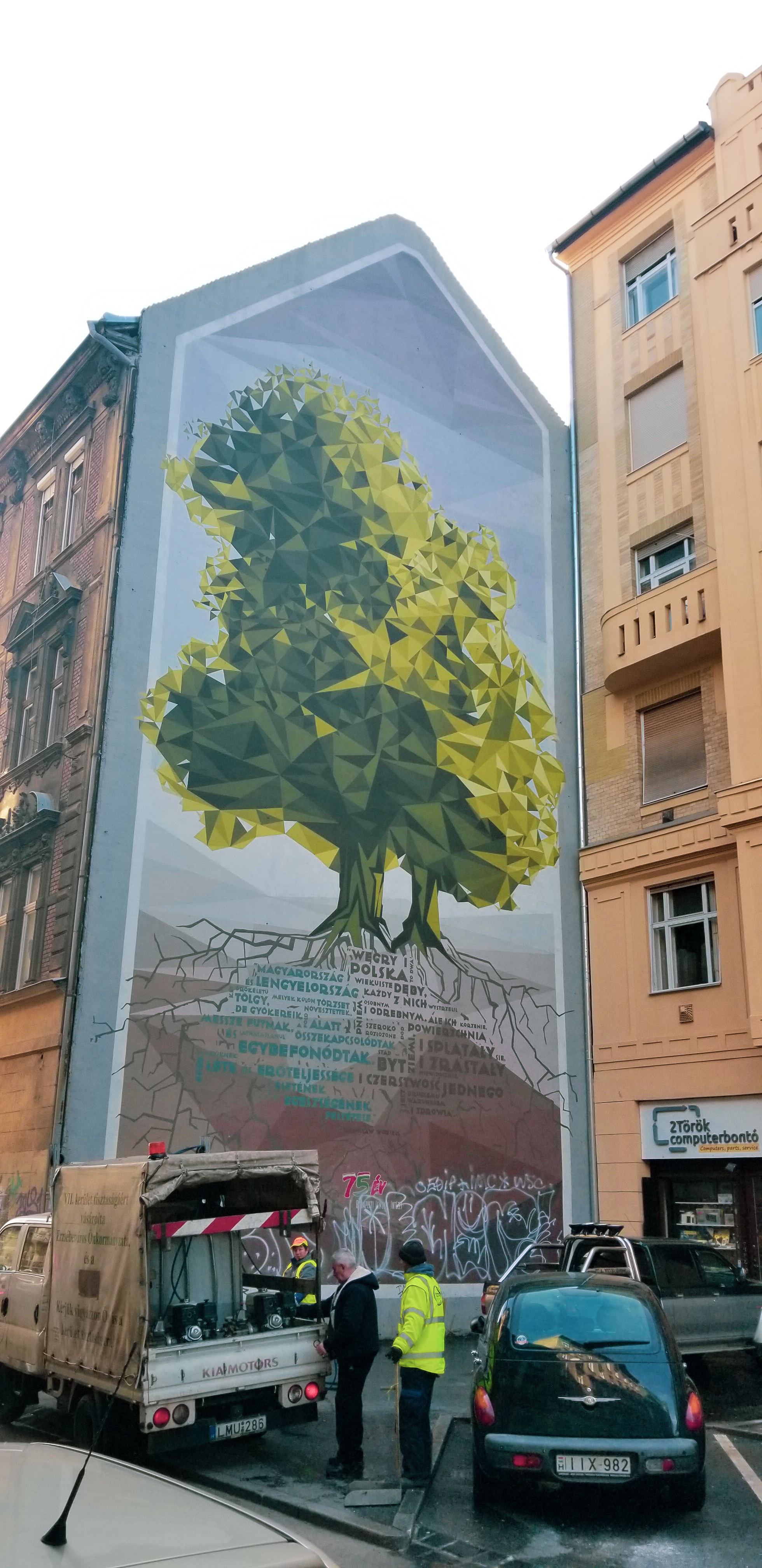 """A creation by the group  Neopaint , this mural shows the common ties between Polish and Hungarian cultures. The words read: """"Hungary and Poland are two forever-living oaks, which have their own trunks, but their roots are far beneath the earth: they have joined and invisibly merged. So the existence and strength of each one is tied to life and health of the other."""" — Stanislaw Worcell"""