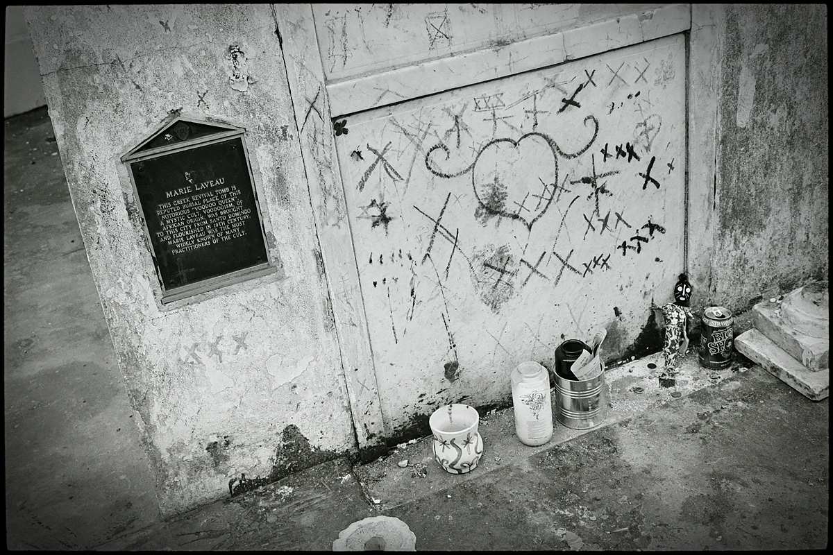 Followers leave markings and mementos at the tomb of Voodoo queen Marie Leveau