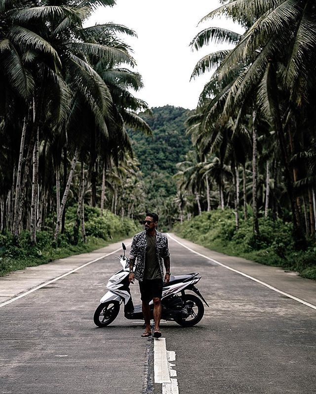 I have no clue why I've parked up my scooter *(actually it wasn't even my scooter it was my guides, as mine was old and crappy) in the middle of this deserted road in Siargao. It has no context at all, I mean why?!!! But I did it anyway and this was the outcome. 🤷🏽‍♂️ Seriously though if you're going to the islands of the Philippines, it's such a great way to explore but always drive safely and carefully especially if you've never rode a motorbike before and in the rain halve your speed. Yes I may sound like your parent, but when I was riding mine, I always thought of my loved ones who would miss me if I was gone and also all the things and goals that I still want to achieve in life. Your life matters. Cherish and care for it. 🙏🏽 #siargao #philippines #travel