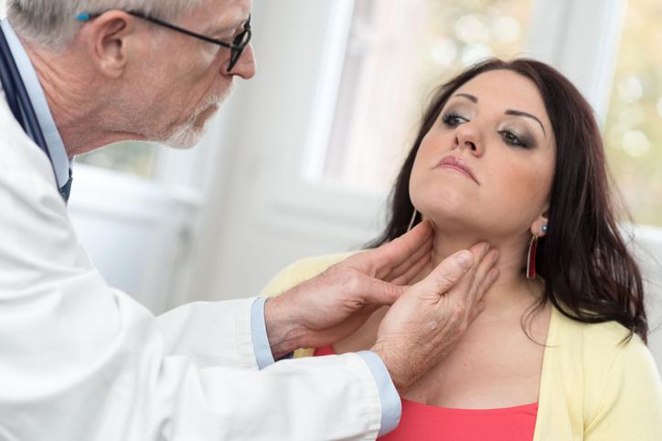 doctor inspect thyroid.jpg
