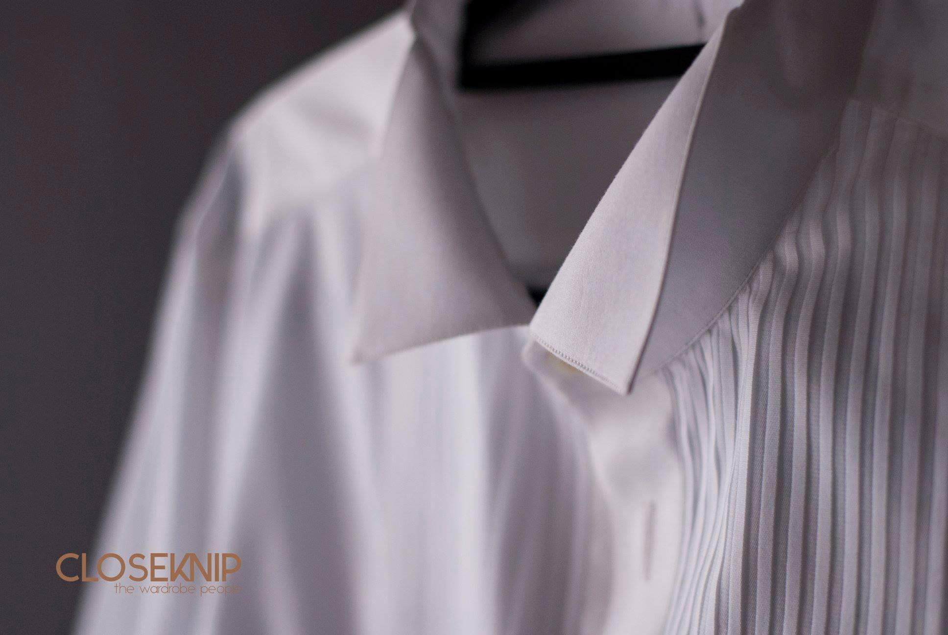 Classic wingtip tuxedo shirt with a pleated bib front.