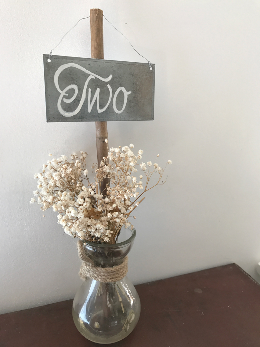 Bamboo stick & tin sign £1.00