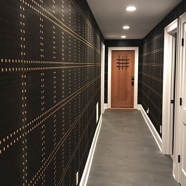 These @phillipjeffriesltd Rivets were exactly what this basement hallway needed. #interiordesign #brassdetails #wallpaper #rivets #phillipjeffries #basement