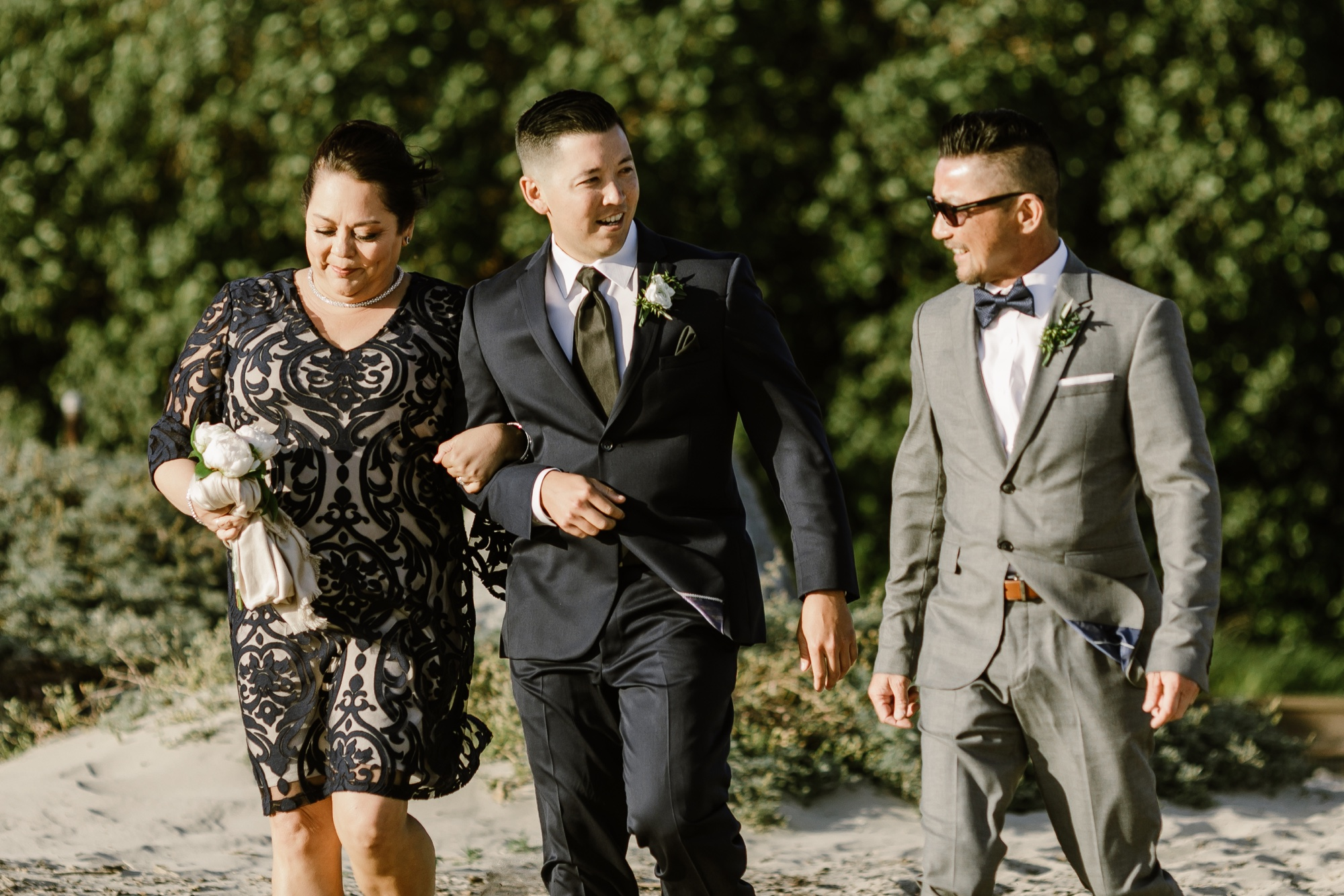32_Ally and Tommy's Wedding-120_groom_walking_down.jpg