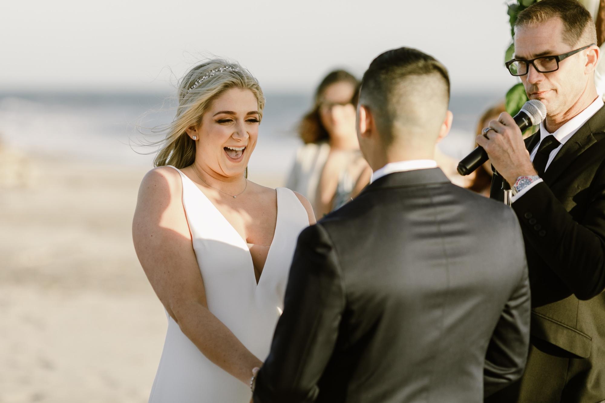43_Ally and Tommy's Wedding-150_club_beach_laughing_rincon_wedding.jpg