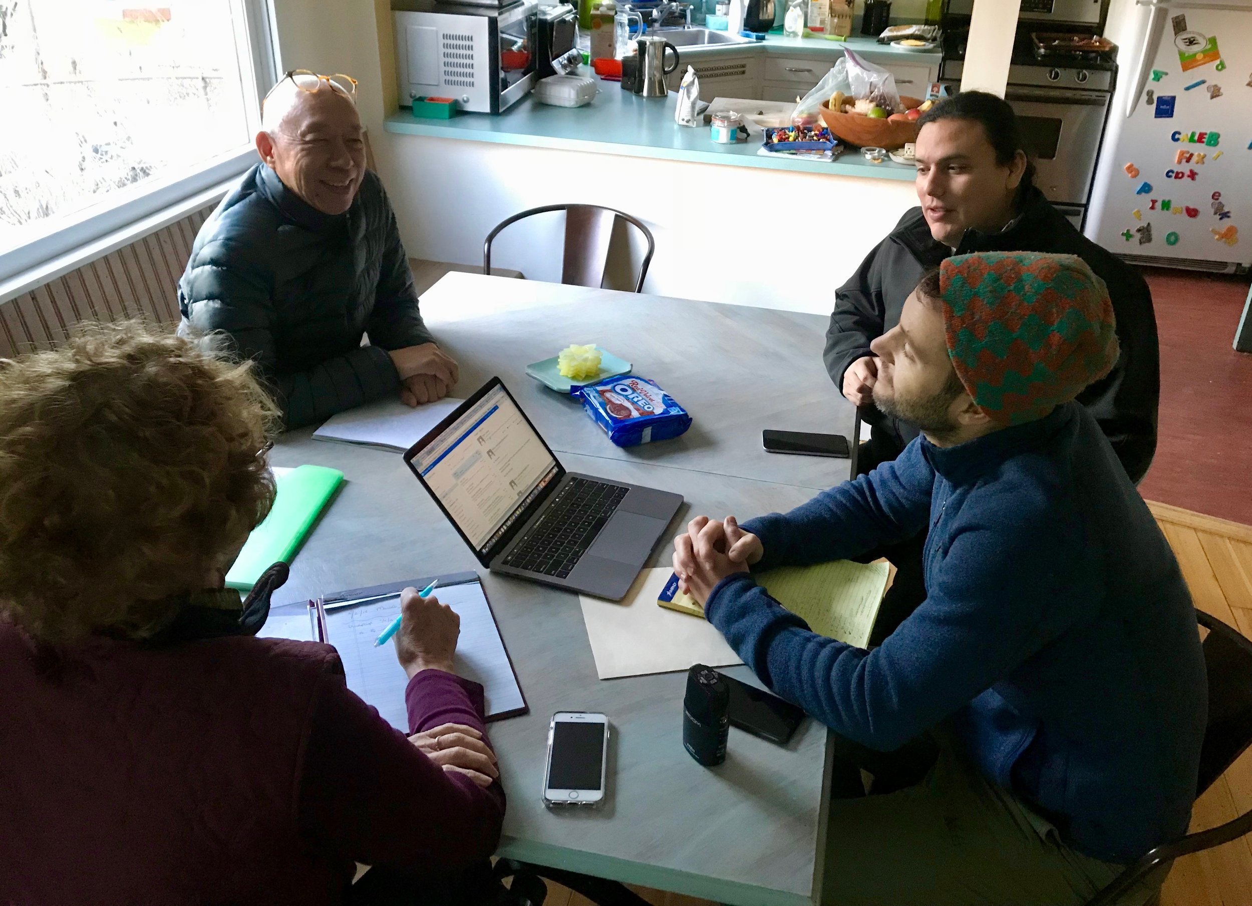 Smith calls in for an interview while Sue, Ping, Frank, and Ryan listen, February 2018.