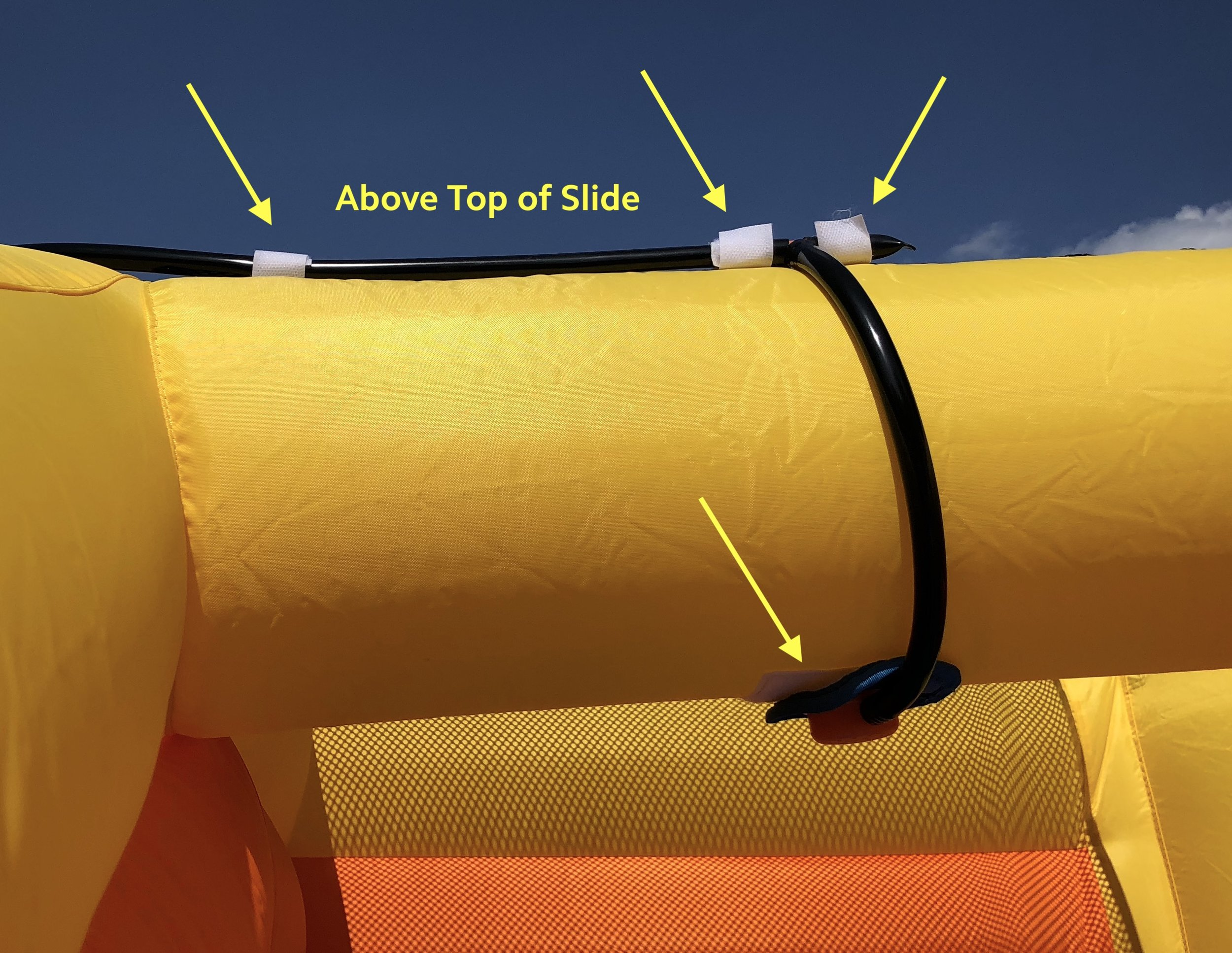 8a. Attach the sprinkler above the top of the left slide using Velcro.  Secure the hose using the additional Velcro straps.