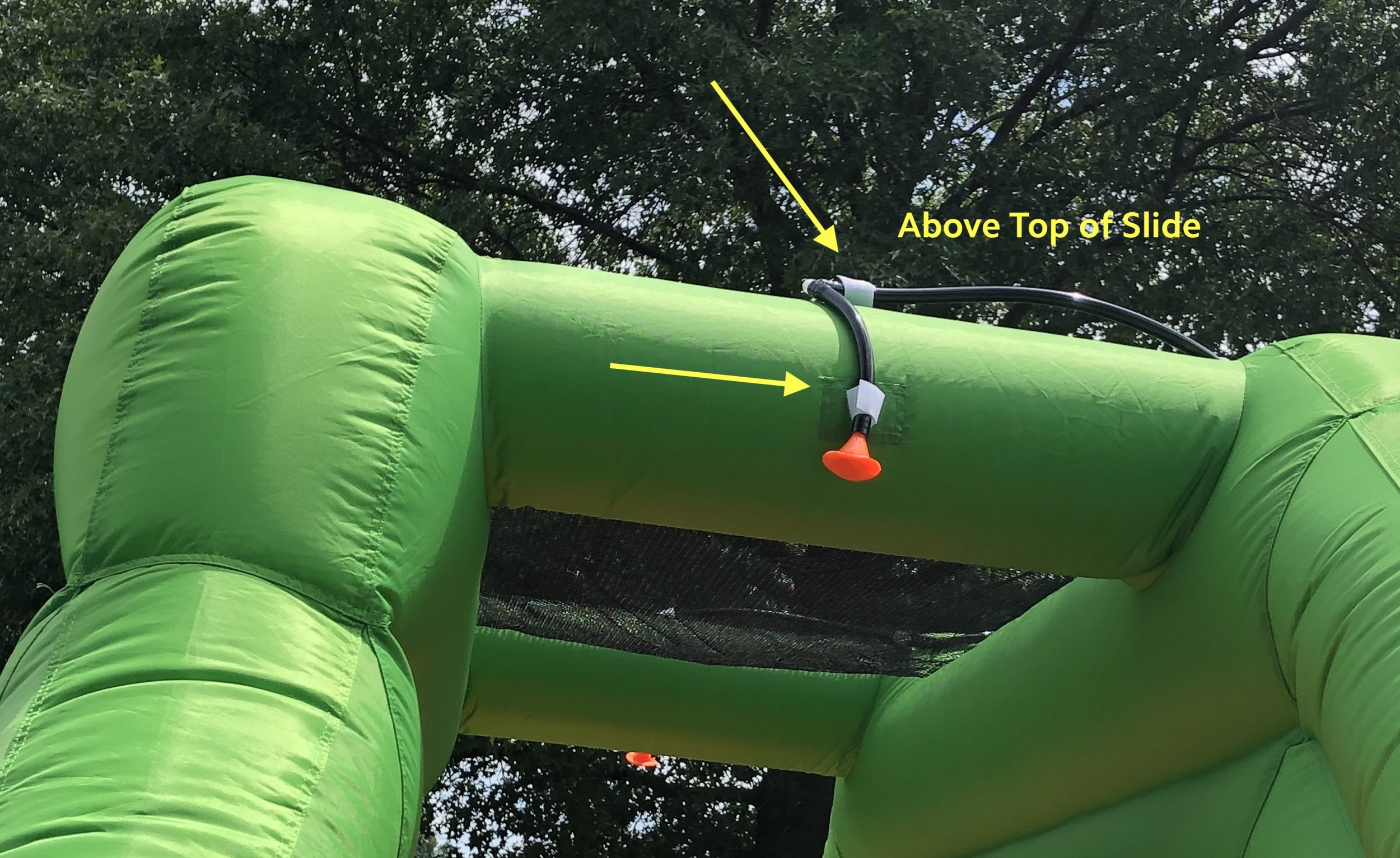 8a. Attach the sprinkler above the top of the right slide using Velcro. Secure the hose using the additional Velcro straps.