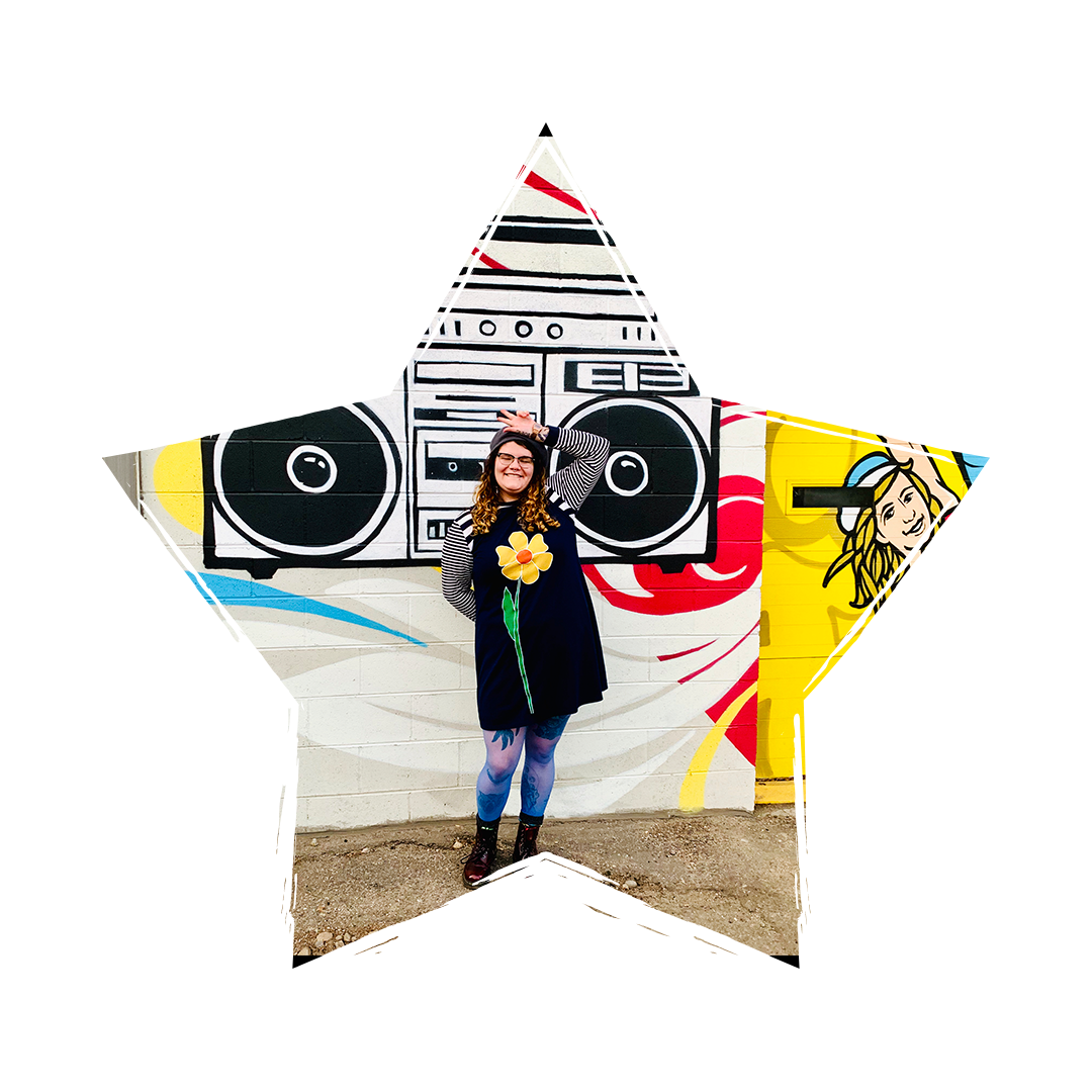 [Image] Madeline Stein standing in front of a graffiti wall with her hand on her head, the image is in a shape of a star. Madeline Stein offers individual counseling and group counseling for gifted children and gifted teens in Denver, Colorado.