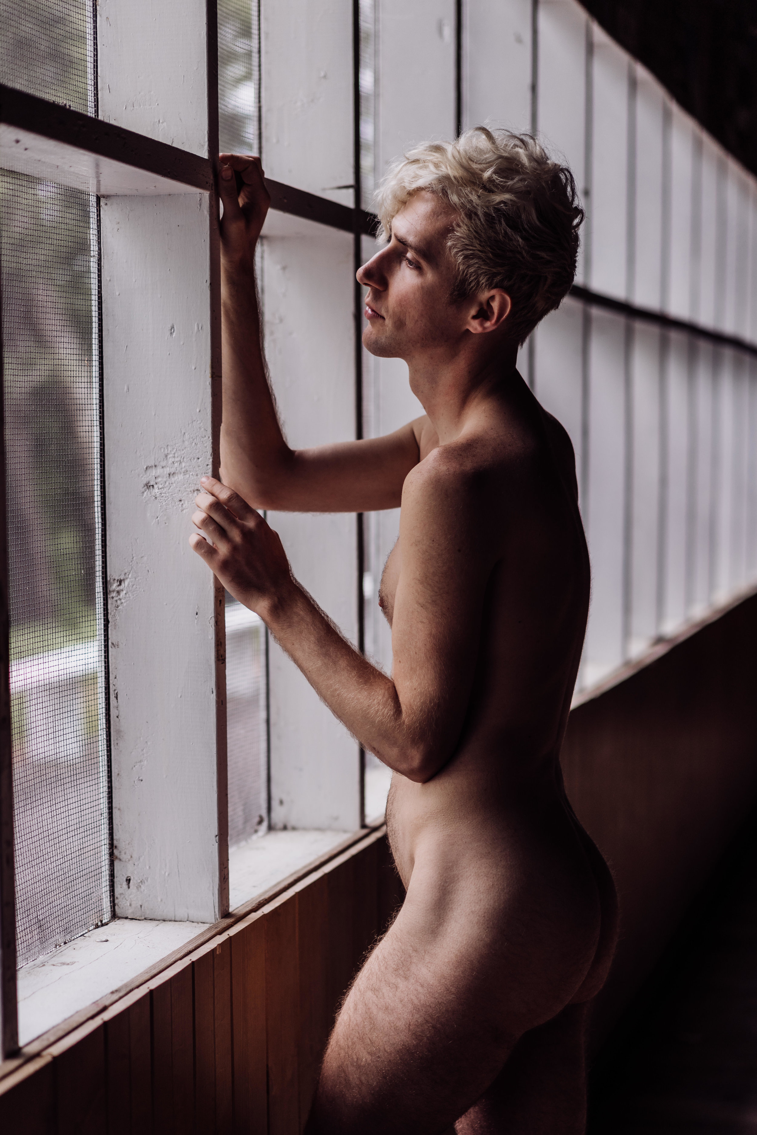 Oklahoma city male boudoir man standing in front of window