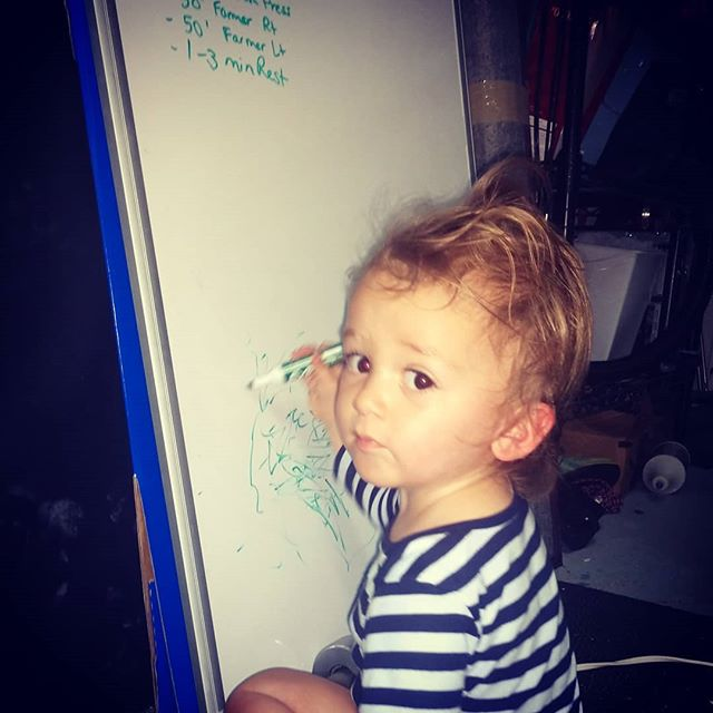 My workout partner is writing his workout on the board. Michael loves being in the garage gym. Do I prefer to do this without him? Yes. Is that always possible? Nope. #fitness #BIRTHFIT #birthfitbabies #garagegym #momlife #getitdone #alwayswatching