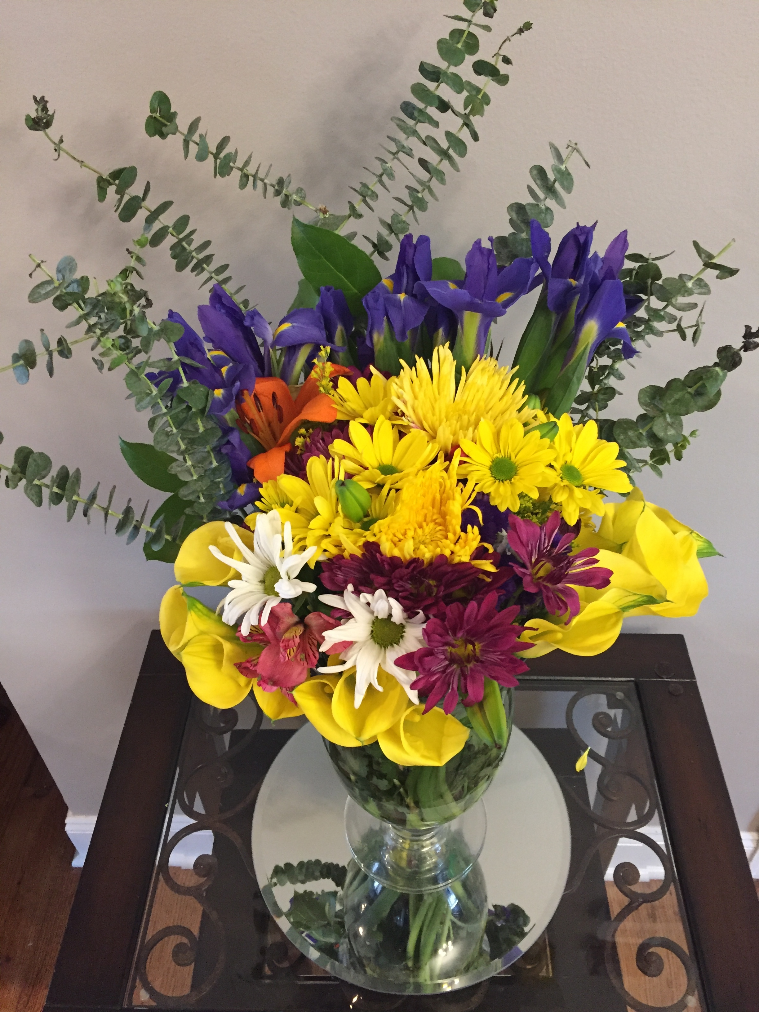 Bright and Colorful Florals are a pleasing seasonal accent - whether fresh or permanent. They are also a perfect way to add a pop of color.