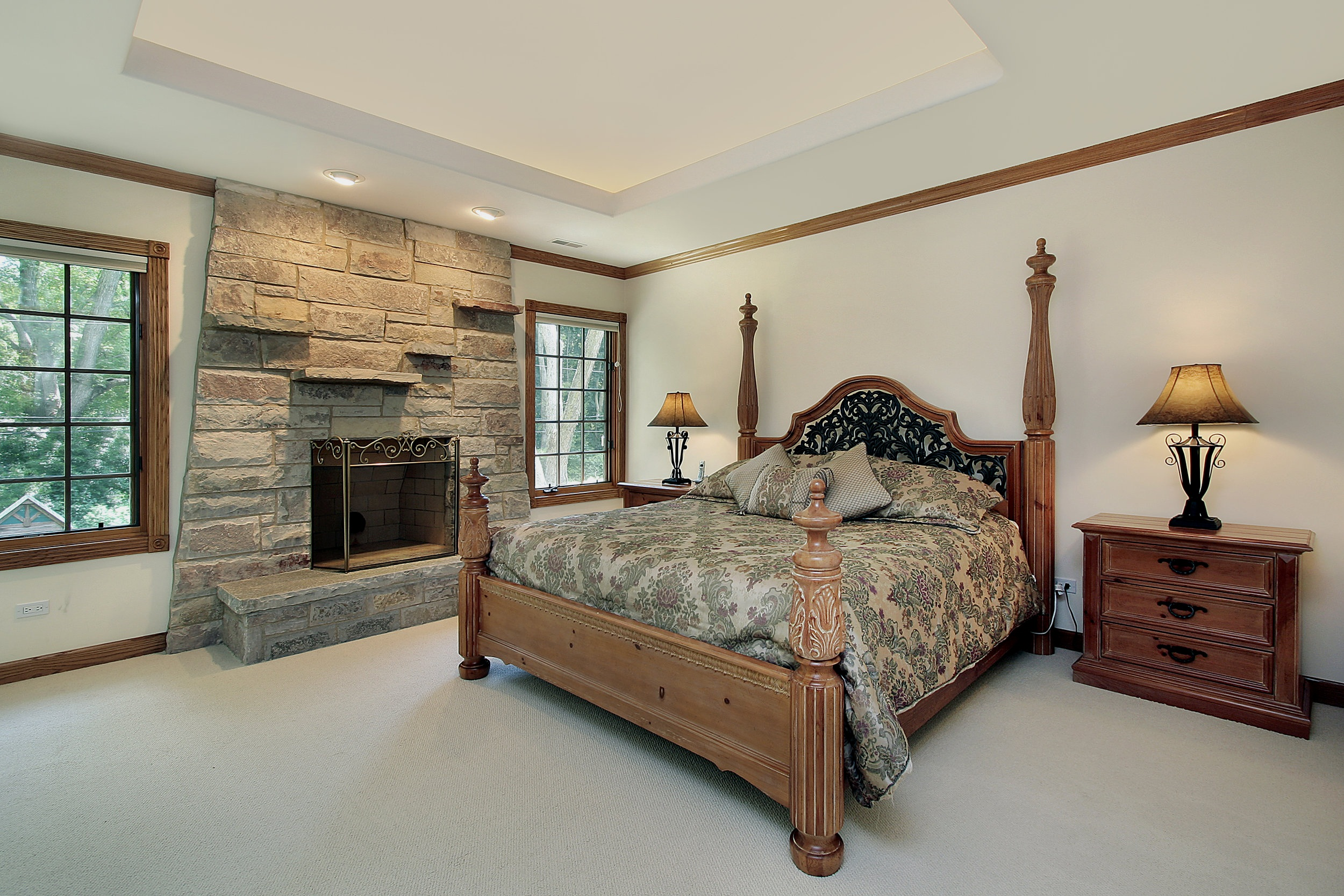 Master Bedroom in Luxury Home with Stone Fireplace
