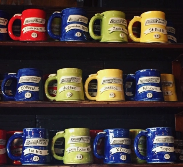 Crooked Tooth Mugs on Shelf
