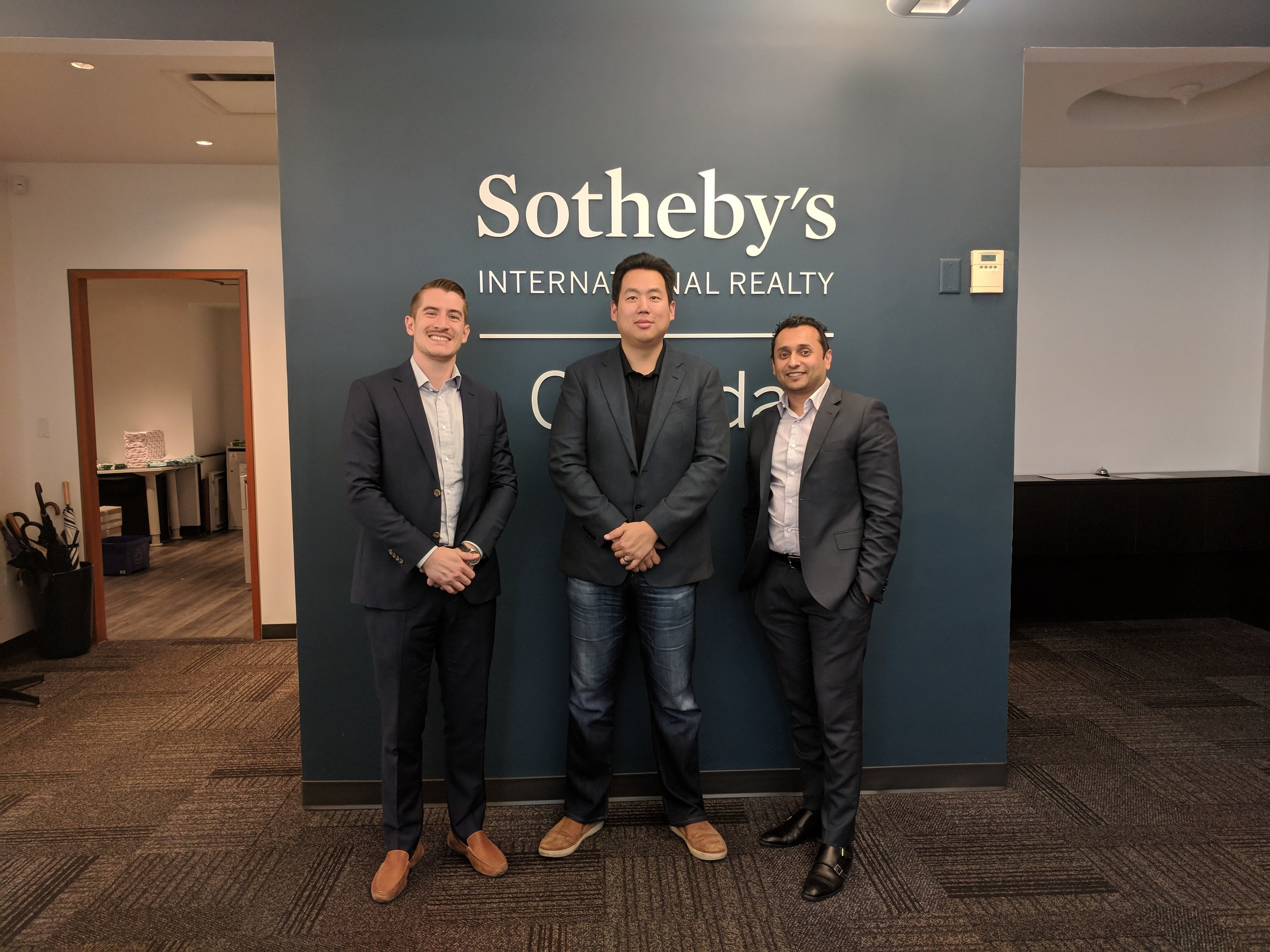 Chang (center) pictured with affiliates from Sotheby's International Realty Canada including Karim (right).