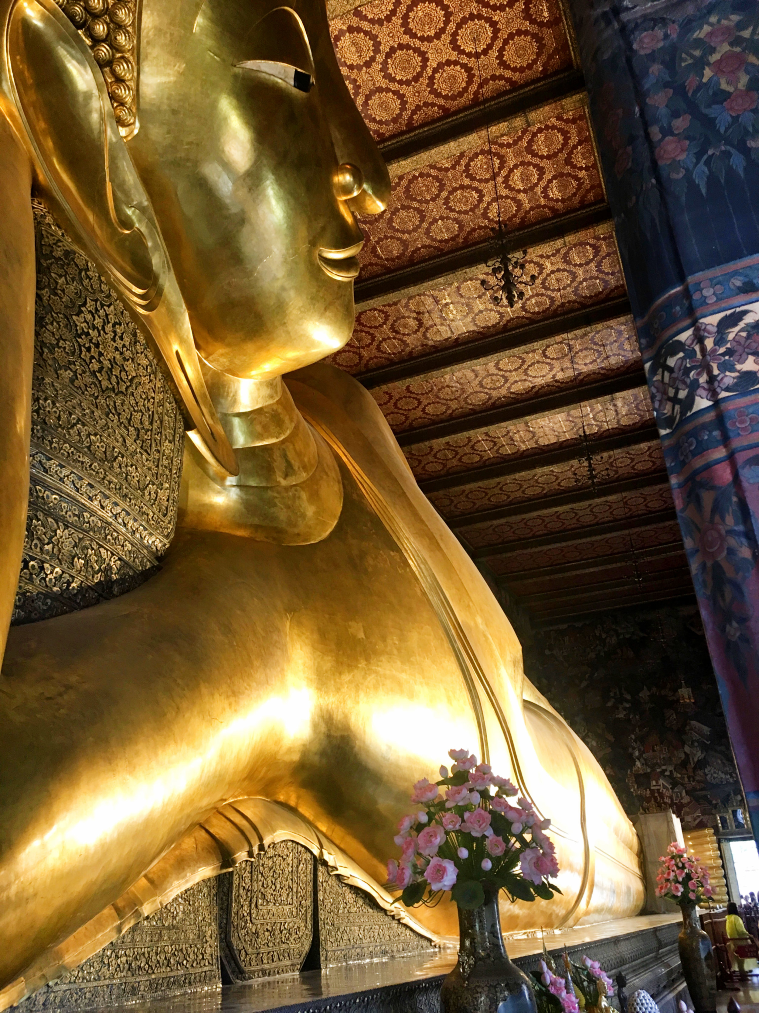 Side view of large reclining Buddha in Bangkok