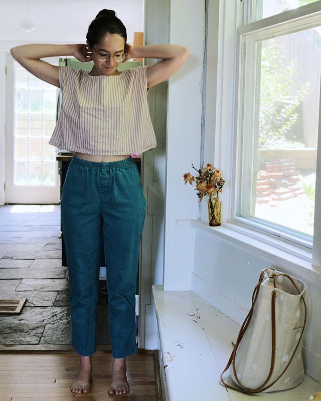 it's so hot these days and we refuse to turn on the air conditioning, so when I feel comfortable in my clothes I really notice it. these aren't the studio pants, they're thrifted pants straight from the nineties made out of strange stretch denim, but they're inspiring me with their comfort and I'm taking notes on how it feels to wear them. My goal is to make the studio pants feel even better to wear. somehow. I'll figure out how. it takes a long time and they're really close, though I keep finding things to tweak, little details and edits to shape, sampling in different fabrics to play with drape and the way they lay on the body. finding inspiration all over the place, internalized by both my body and my mind. How exciting to get to figure out how to make clothes exactly how my body needs them to be. paired with an #allwellboxtop in old secondhand cotton ticking (stiff so sticks out from the body, lots of room for air to move) and I'm feeling breezier than I should get to feel in this weather. summer clothes, I'm taking note. #allwellprocess