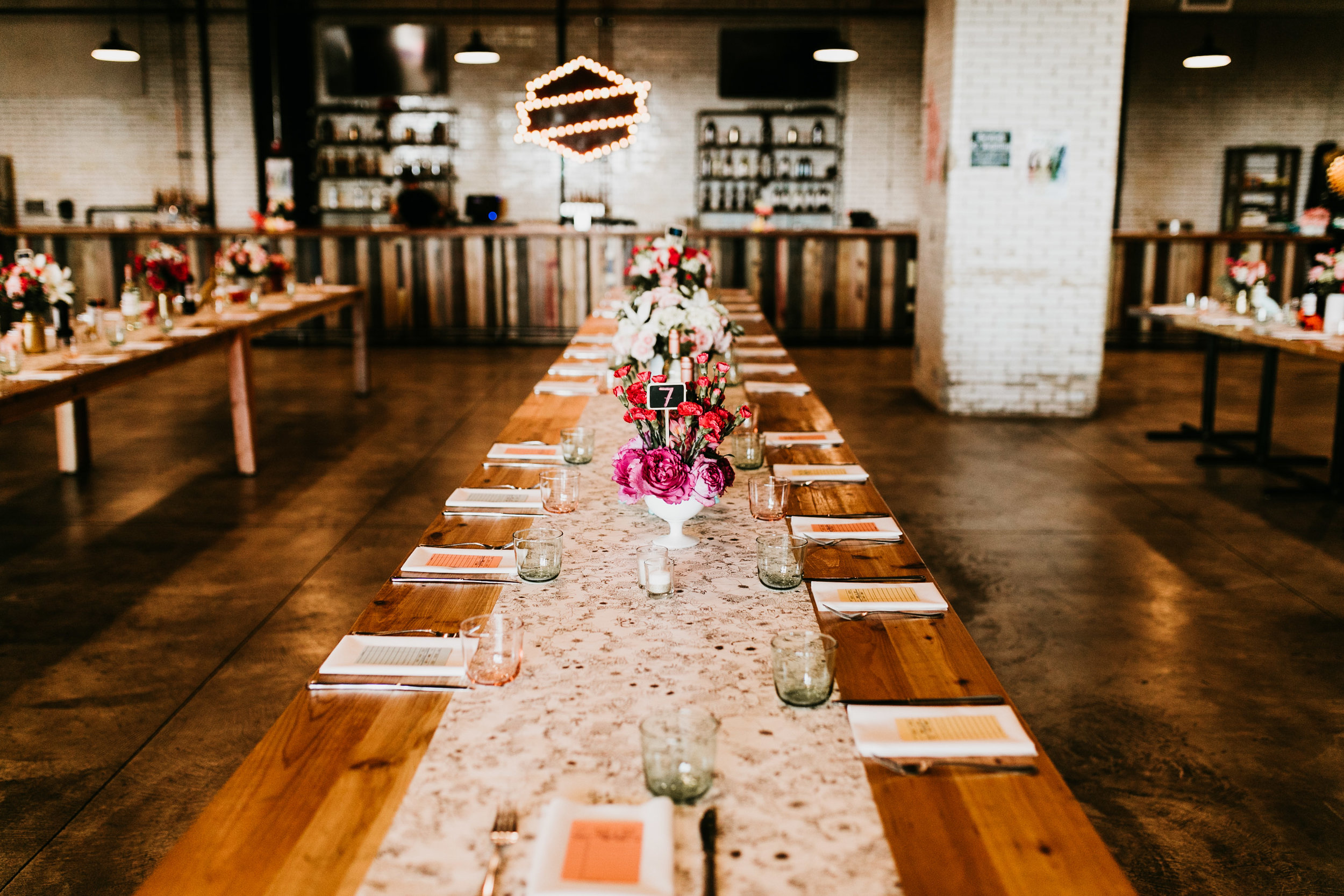 uprooted-traveler-how-to-have-a-vegan-wedding-tablescape-old-bakery-beer.jpg