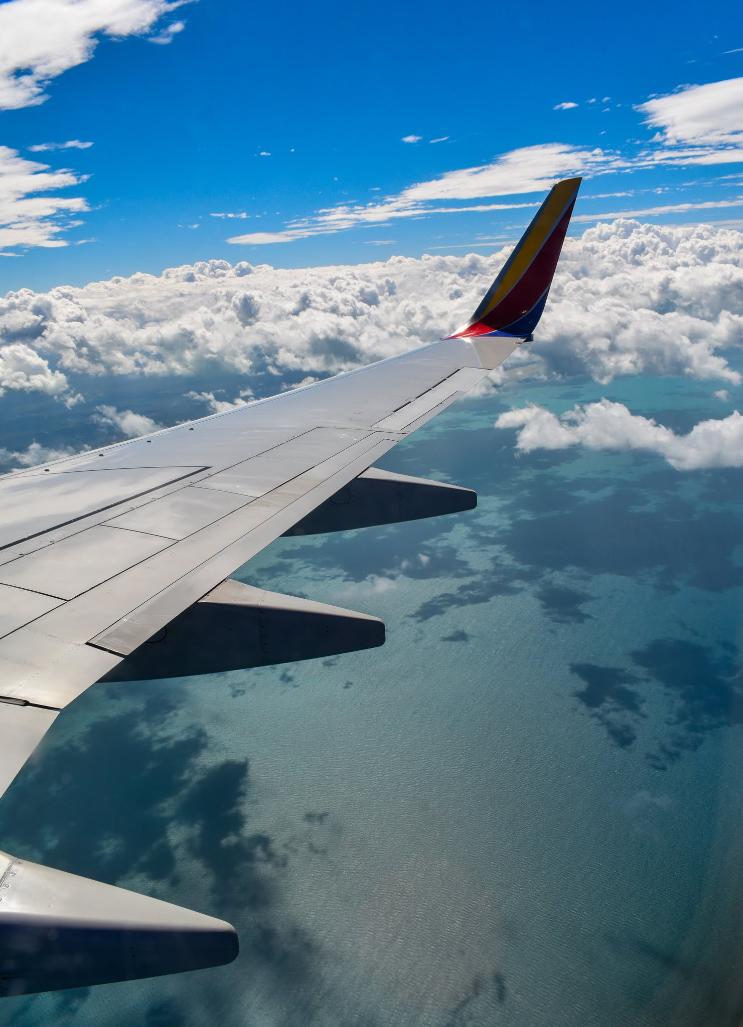 Uprooted-Traveler-Vegan-Weekend-in-Tulum-Mexico-how-to-get-there-airplane-window.jpg