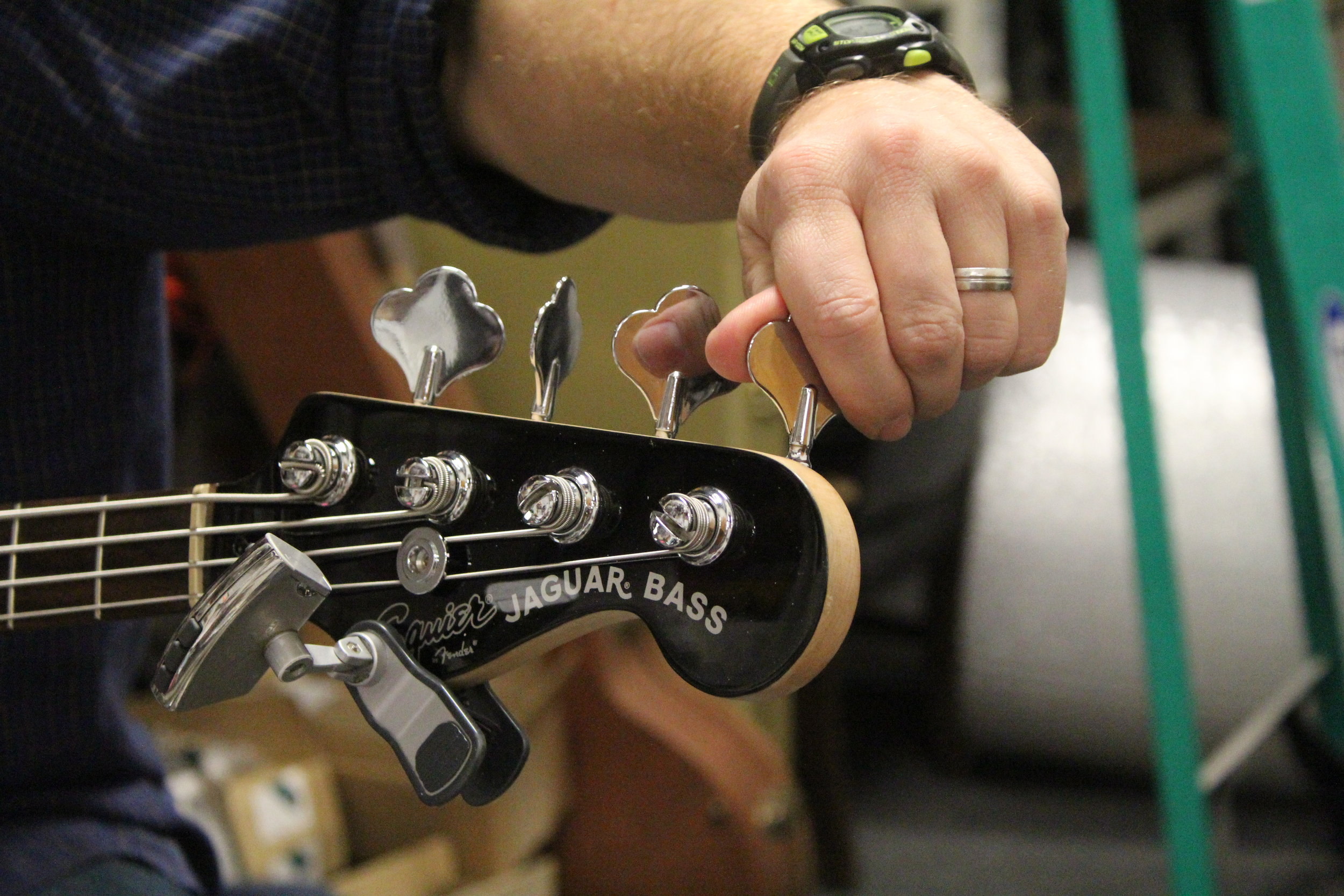 Brent Moore tunes a bass on Friday, Jan. 19, 2018 at CoMo Guitar Works in Columbia, Mo. Moore says this bass is a birthday present for his daughter.