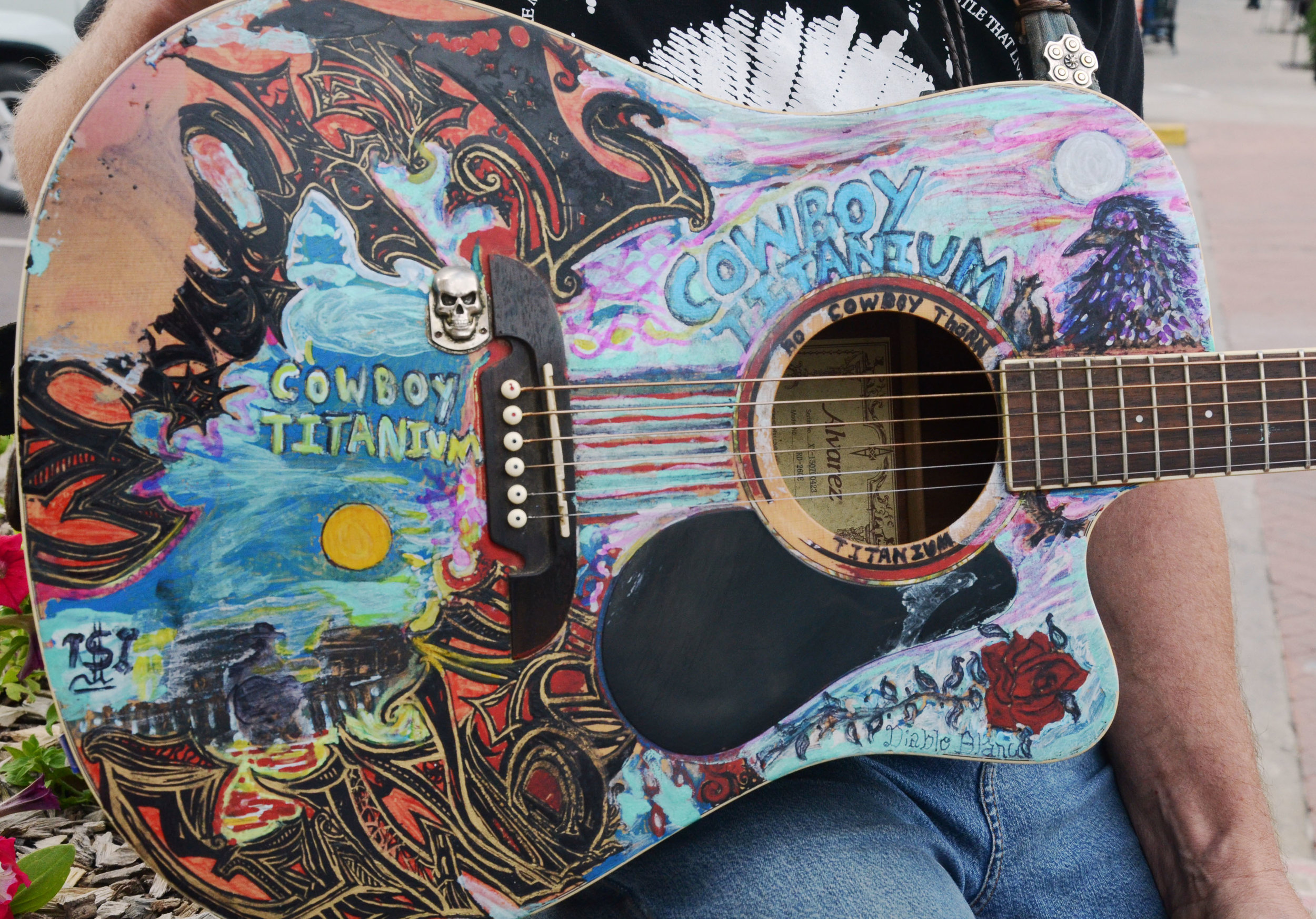 """Robert shows us his guitar. """"This guitar is over ten years old and I created most part of it. It has my name on it. Many people buy really expansive guitars as collections, but for a musician, we buy a guitar just for the sound."""" Robert said."""