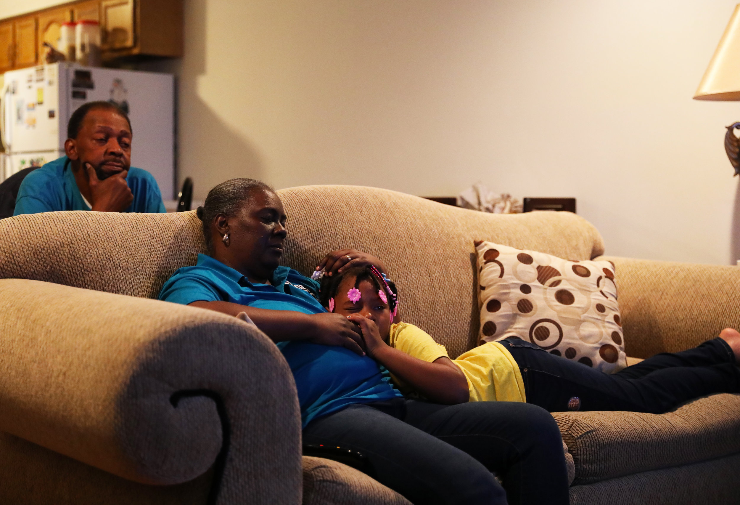 "Tammy Kelliehan, grandmother of four grandchildren, accompanies her granddaughter Idelayjha Lewis-Scott sitting on the sofa and watching the TV show before having dinner on Saturday, Oct. 27, 2018 in Columbia, Missouri. Kelliehan laughs and strokes Lewis-Scott's head. Lewis-Scott is the one grandchild who calls Kelliehan ""Mimi"". Other grandchildren call her ""Mima"". (Photo by Yanran Huang)"