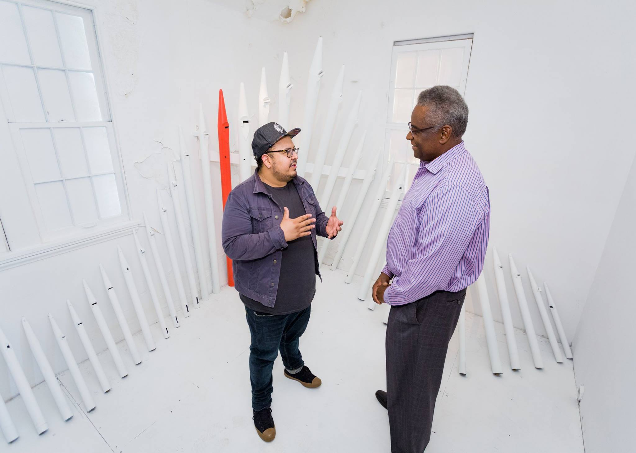 Fernando talking to a guest visiting ArtPrize Nine entry.