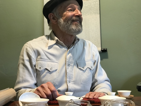 A candid of David Lee Hoffman at his tea table, with his gaiwans,by adoring fan,me!