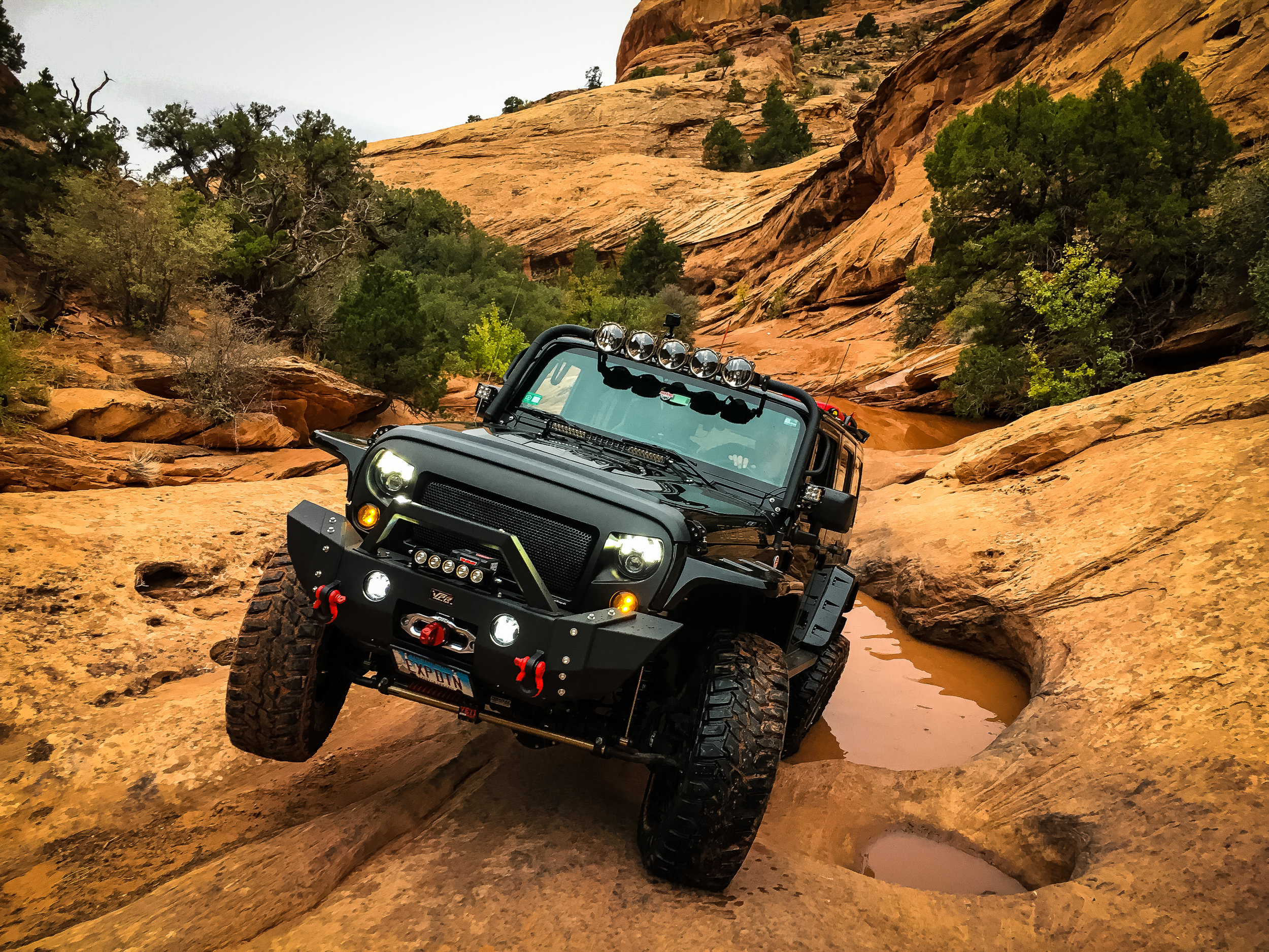 """This was a section of Golden Spike, through a muddy creek and then these great tippy, slippery holes. Directly in front of me awaits a ~40"""" off camber ledge…"""