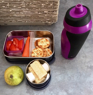 A typical school lunch for our daughter: morning fruit, recess, lunch and a bottle of water. -