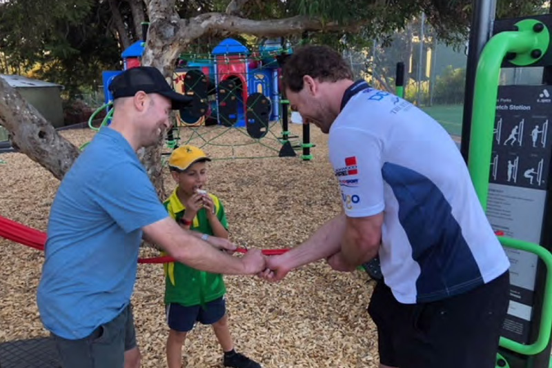 Matt and Bernie cutting the ribbon to open the new Playground