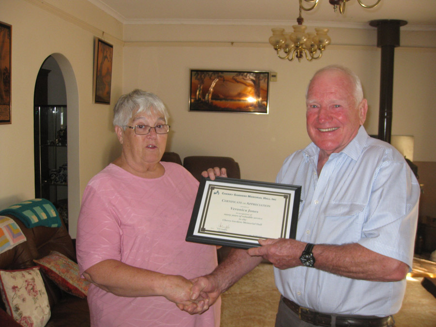 Terry presenting Veronica with her certificate.