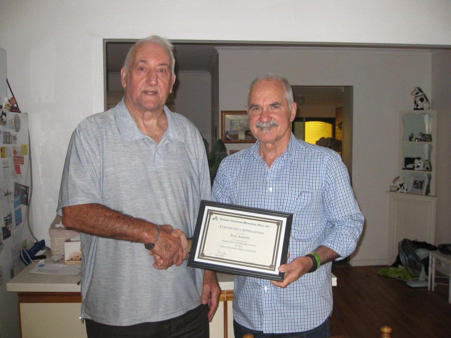 Bill presenting Eric with his certificate .