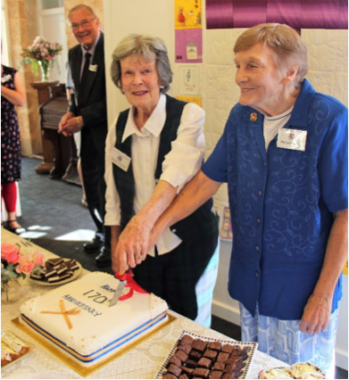 Margaret Bennett and Margaret Jacobs cut the 170th Anniversary cake