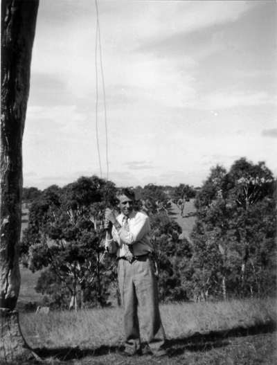 Murray Brumby ringing the bell when it was mounted in a gum tree