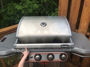 Grill cover off! Let's do it. Oh yeah . . . I gotta open it.