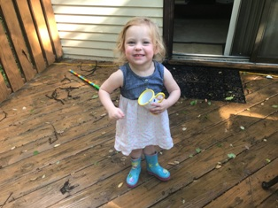 Just kidding - if you want a gross pix like that, then Google it. WARNING - you may vomit at what you see. Anyway, here's a cute picture of my Violet.  Hmmm - See that broom in the back?