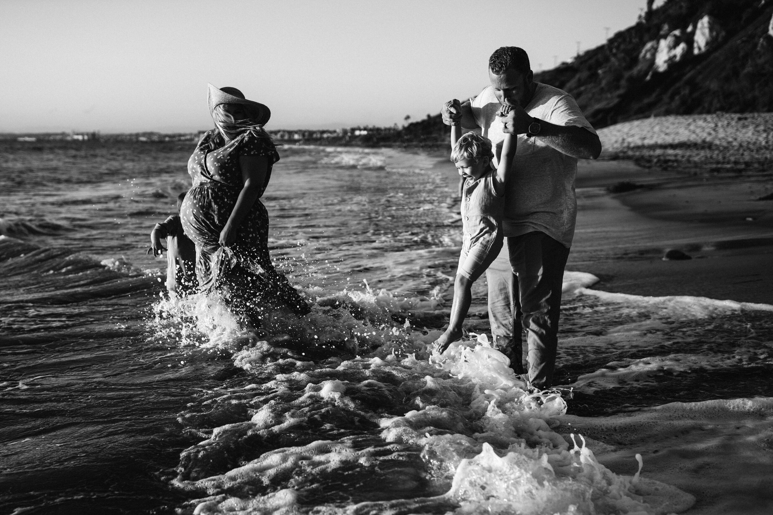 family in crashing waves photoshoot
