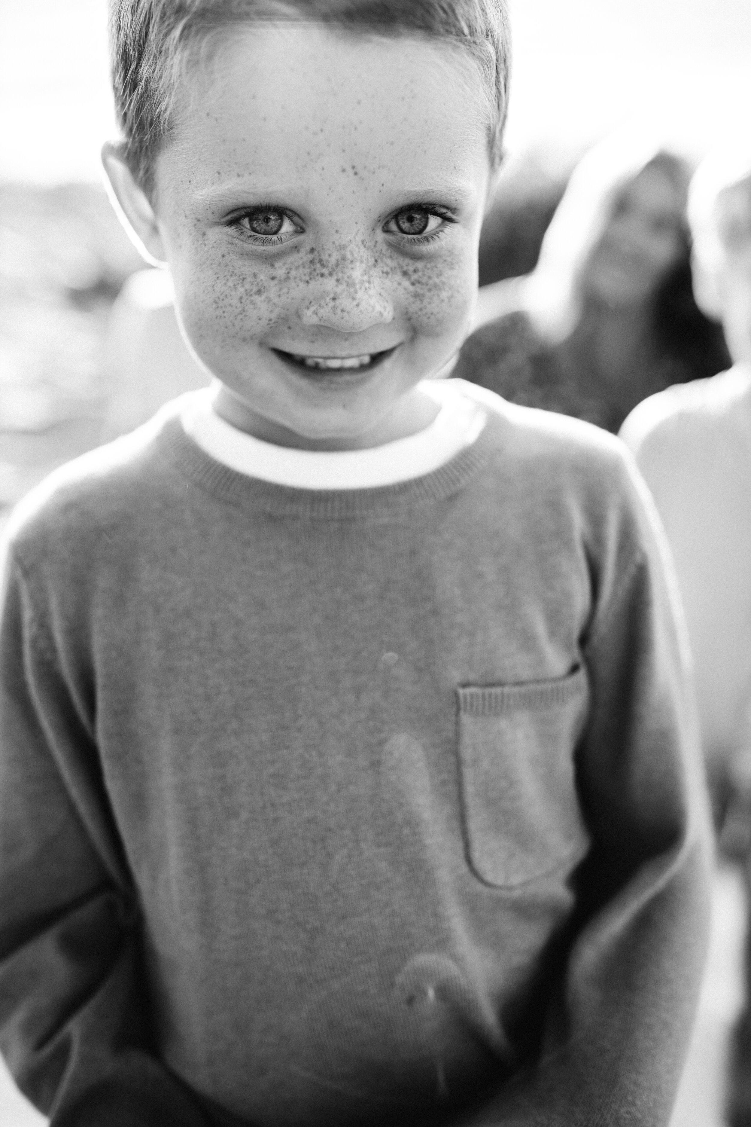 son smiling at camera - Lindsay Petty Photography
