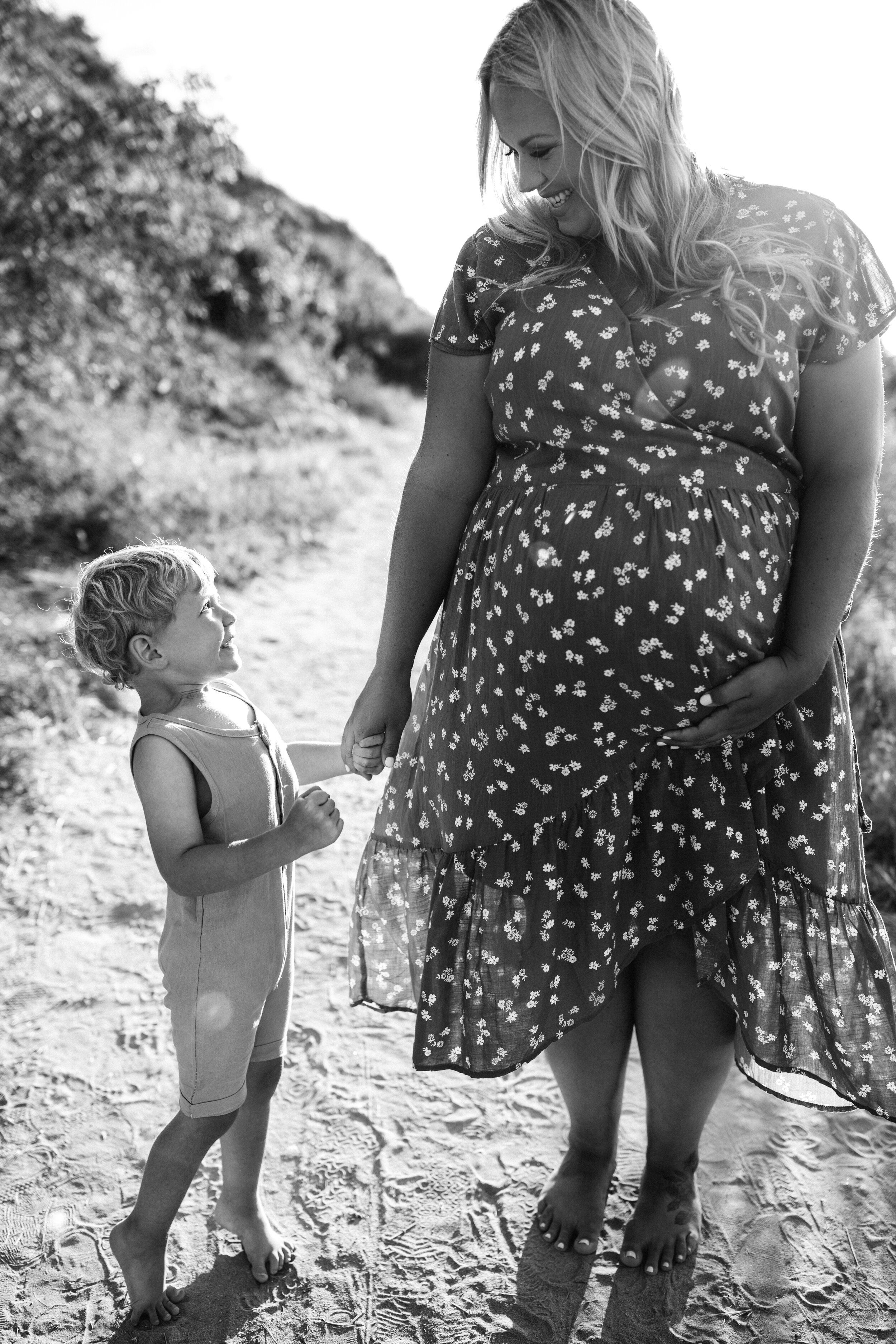 son looking up to mother on beach - Lindsay Petty Photography