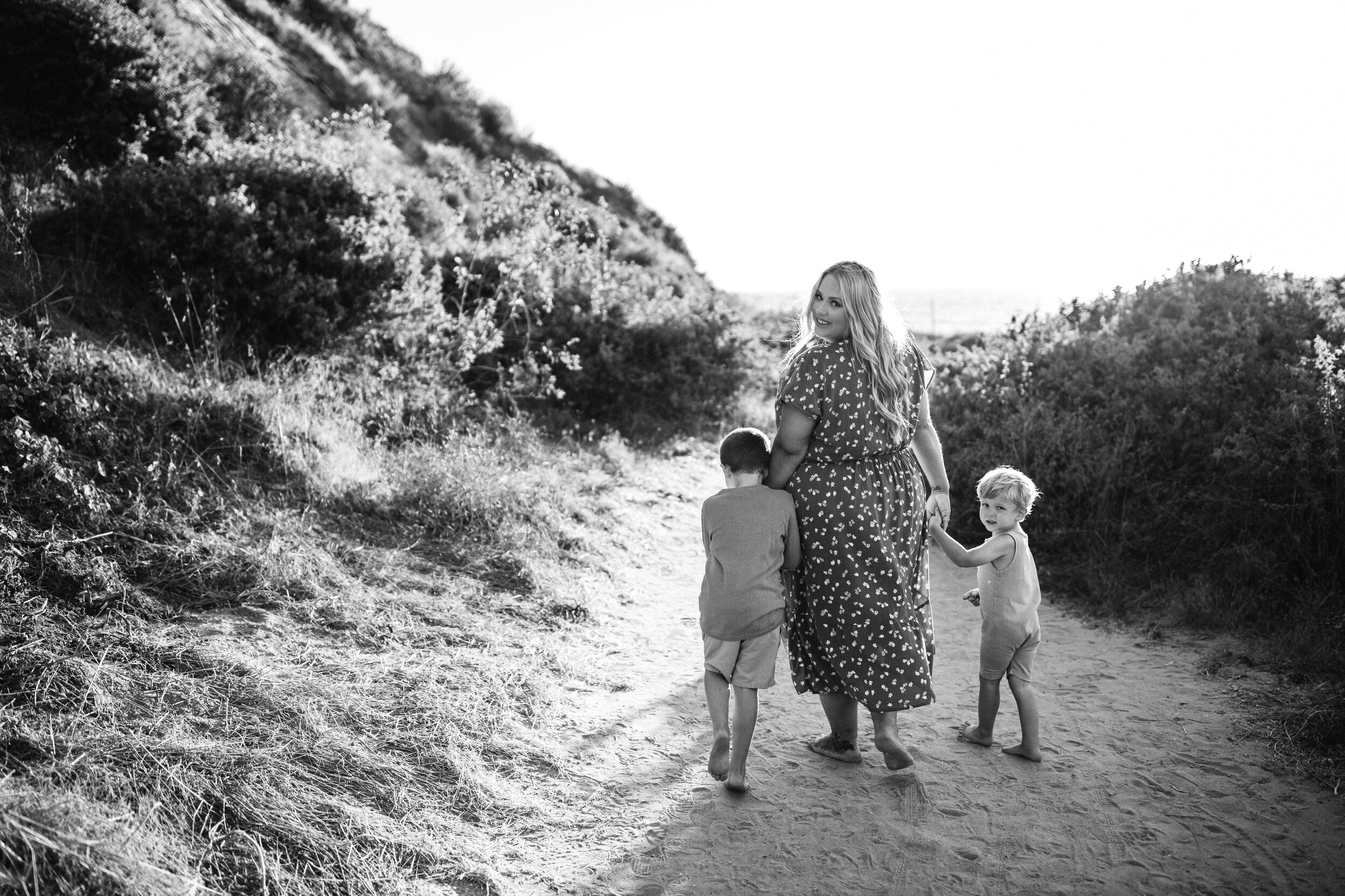 mother and sons walking on beach - Lindsay Petty Photography